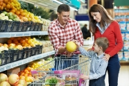 family in fruit section shopping
